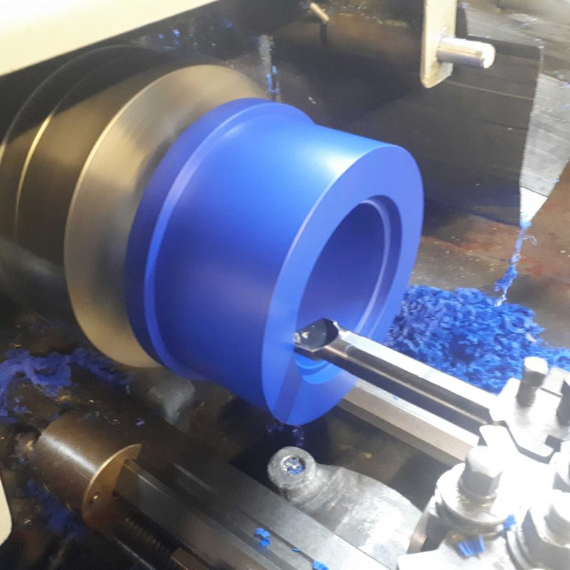 BLUE-ACETAL-BUSH-MANUAL-MACHINING.-custom-machined--acetal-bush-to-fit-scheduel-pipe
