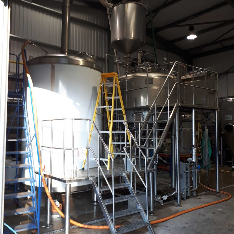 KETTLE-INSTALLATION-AT-DORSET-BREWING-COMPANY-SITE-WORK-SERVICE-WORK-BEVERAGE-INDUSTRY-measuring-up-for-new-pipework-on-the-kettle